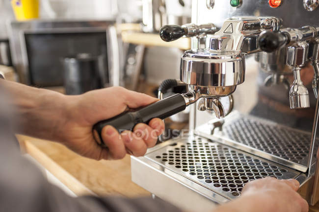 Close-up of male hands Preparing coffee with portafilter machine — Stock Photo