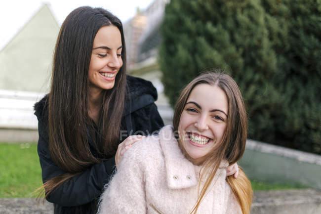 Portrait of smiling female friends — Stock Photo