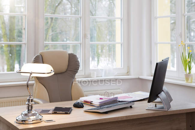Close-up of Desktop with computer at window in office — Stock Photo