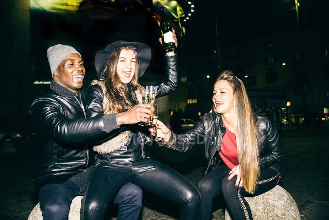 Friends having a party outdoors at night — Stock Photo
