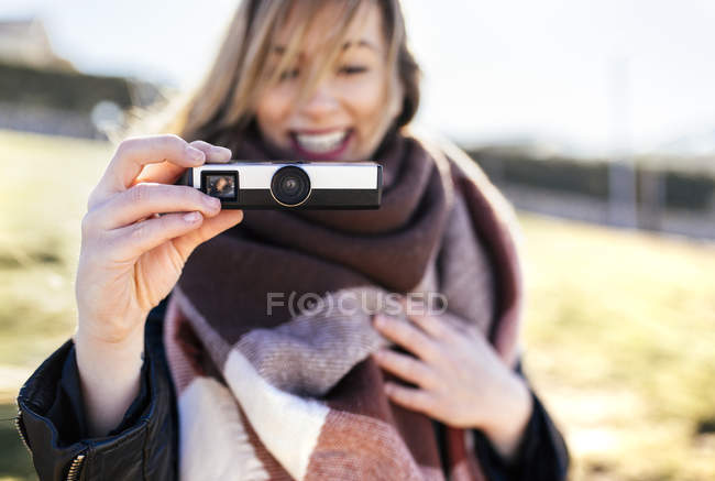Woman taking picture with an antique camera — Stock Photo