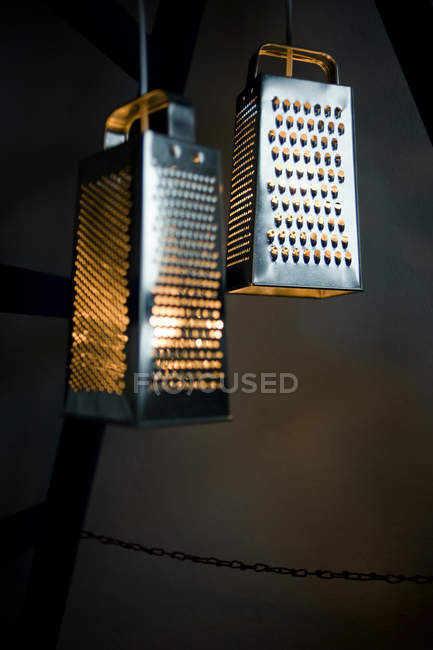 DIY, lamps, made of grater against dark wall — Stock Photo