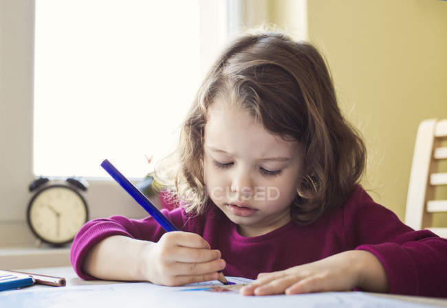Portrait of little girl painting with colored pencils — Stock Photo