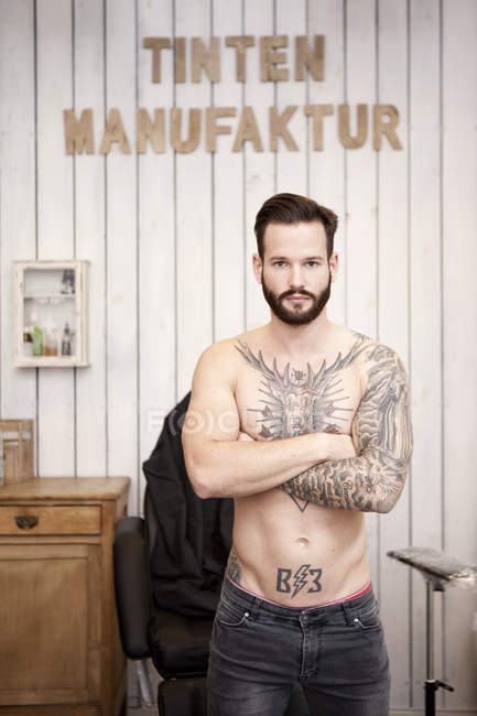 Portrait of man with tattooed upper body — Stock Photo