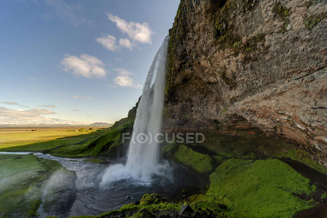 Iceland, flowing Seljalandsfoss waterfalll — Stock Photo