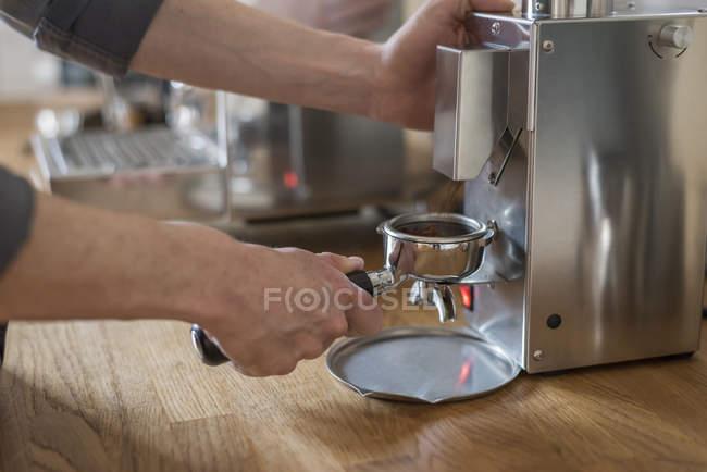 Close-up of male hands Preparing a cappuccino with portafilter machine — Stock Photo