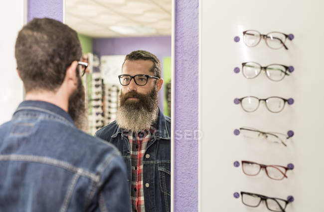 Man trying on glasses — Stock Photo