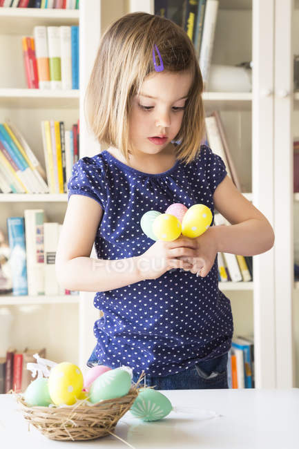 Portrait of girl with painted Easter eggs — Stock Photo