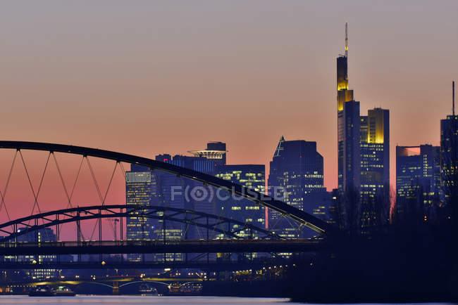 Germany, Frankfurt cityscape illuminated at sunset — Stock Photo