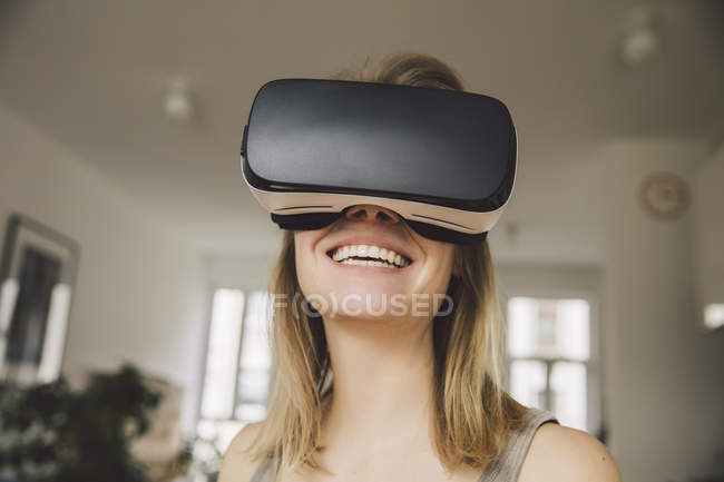 Laughing woman wearing virtual reality glasses — Stock Photo