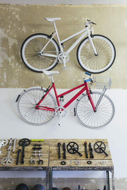 Two custom-made bicycles hanging on the wall in a store — Stock Photo
