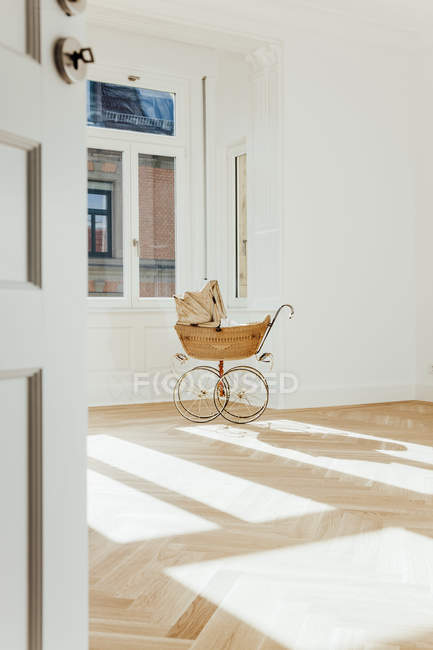 Pram in empty room — Stock Photo