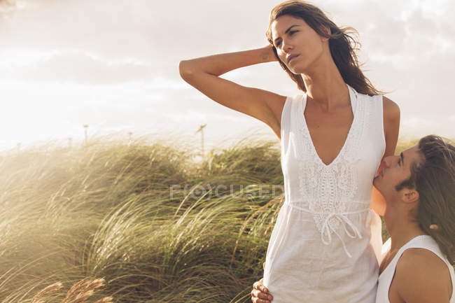 Romantic young couple embracing each other on the beach — Stock Photo