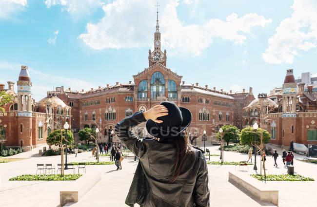 Spain, Barcelona, woman looking at Sant Pau Art Nouveau Site — Stock Photo