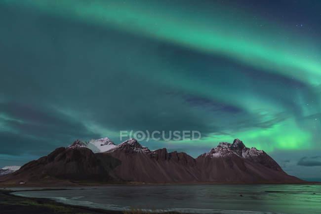 Iceland, Hoefn, Northern lights over Vesturhorn Mountains — Stock Photo