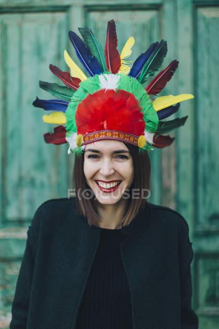 Portrait of woman wearing Indian headdress — Stock Photo