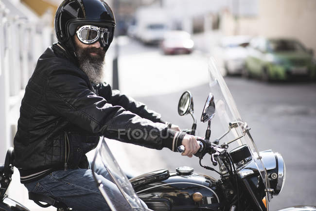 Biker sitting on sidecar motorcycle — Stock Photo
