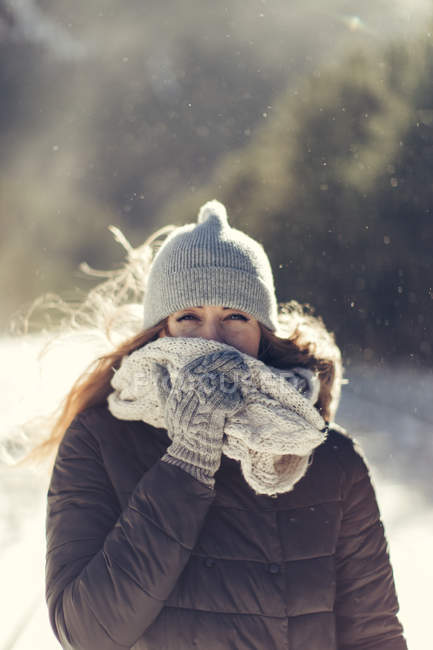 Portrait of woman in nature wearing warm clothing — Stock Photo