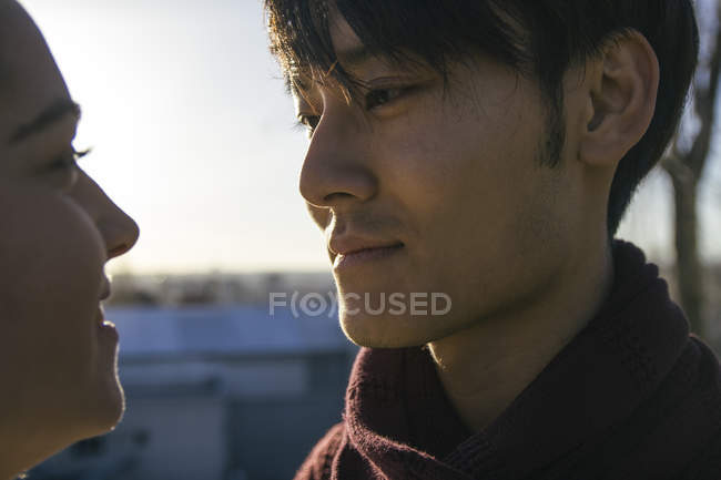Close-up of Young couple in love standing face to face — Stock Photo