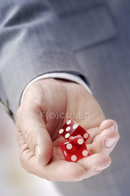 Hand with red dices, closeup of male player — Stock Photo