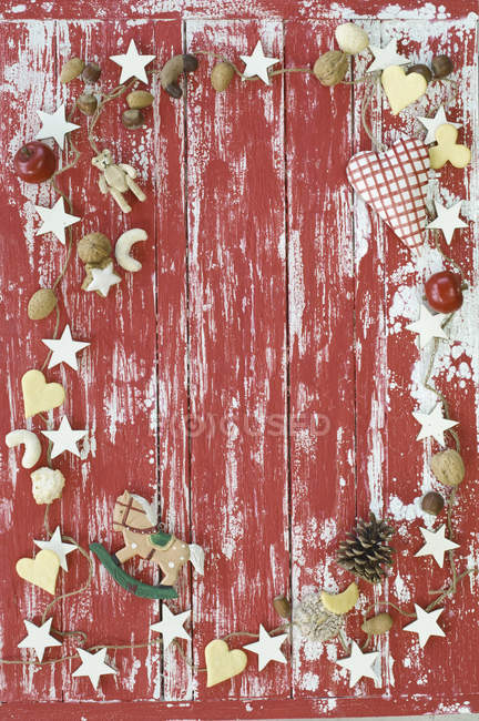 Different Christmas cookies and decoration on shabby wooden surface — Stock Photo