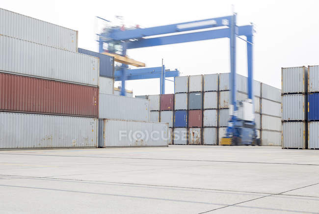 Containers and crane at harbor — Stock Photo