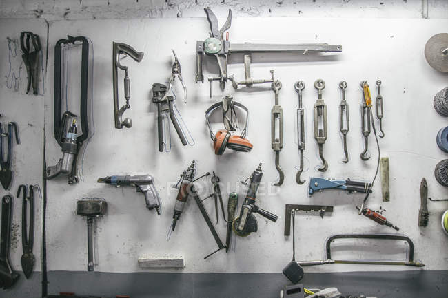 Tools hanging on the wall of a workshop — Stock Photo