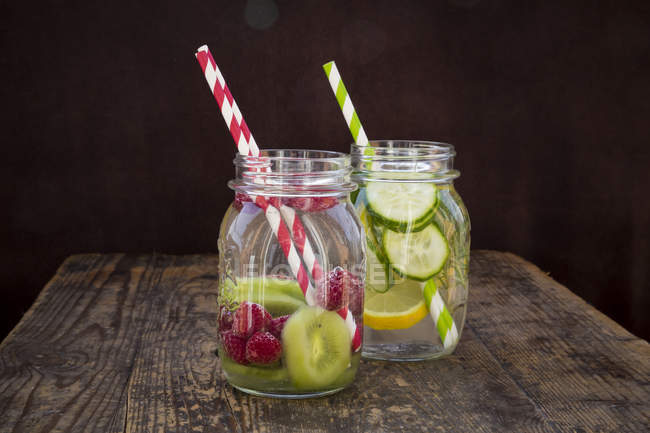 Two jars of infused water with different fruits — Stock Photo