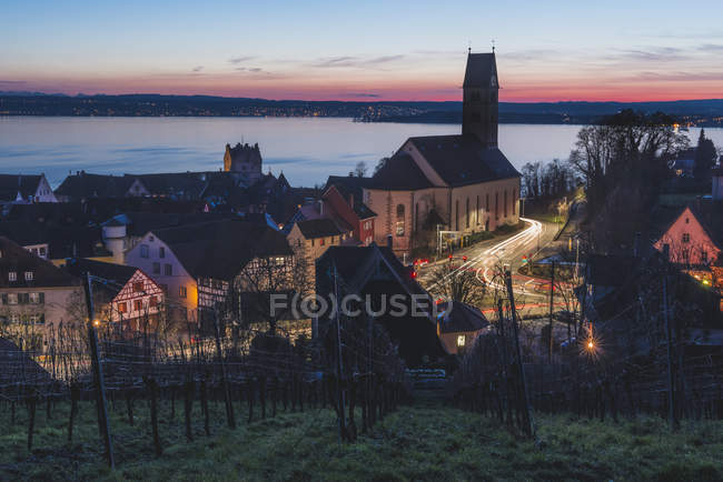 Germany, Illuminated Meersburg by the lake after sunset — Stock Photo