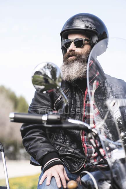 Biker sitting on sidecar motorcycle — Stock Photo