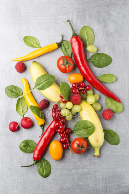 Different fruits and vegetables on metal surface — Stock Photo