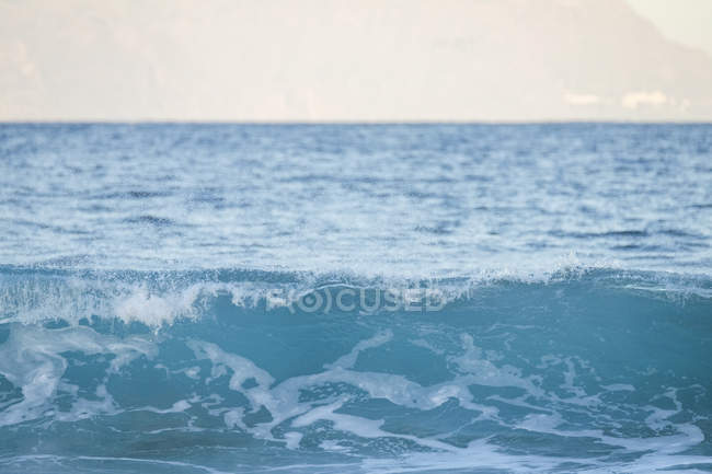 Daytime view of a blue ocean wave — Stock Photo