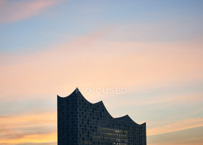 Germany, Hamburg,upper part of  Elbe Philharmonic Hall at sunrise — Stock Photo