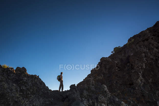 Silhouette of young man trekking at Teno Mountains at evening time — Stock Photo
