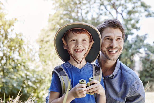 Cheerful father and son together on expedition journey — Stock Photo