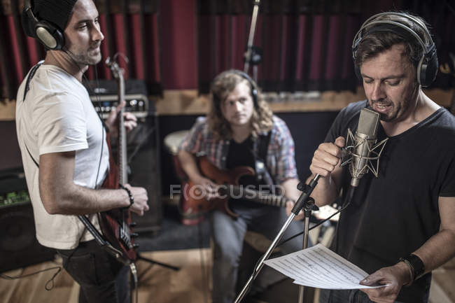 Rock band rehearsal in recording studio — Stock Photo