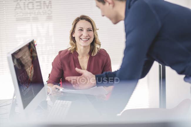 Two laughing business people discussing during informal meeting — Stock Photo