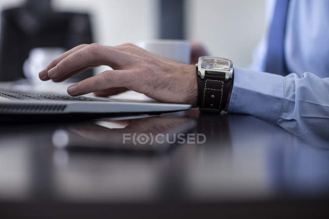 Man using laptop in office — Stock Photo
