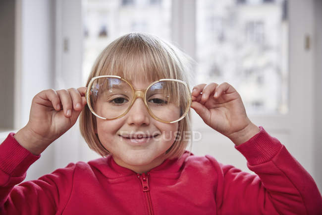 Portrait of girl wearing oversized glasses — Stock Photo