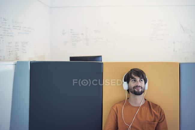 Casual businessman wearing headphones — Stock Photo