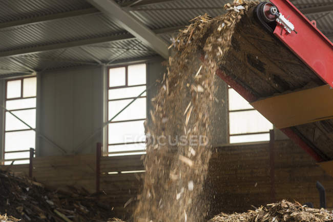 Conveyor system for wood recycling in plant — Stock Photo
