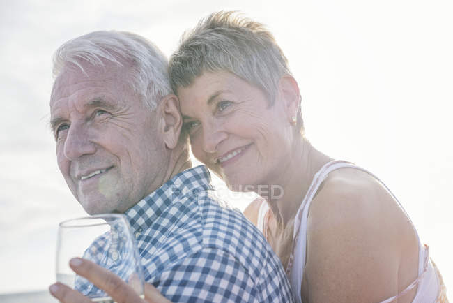 Affectionate couple having a drink outdoors — Stock Photo