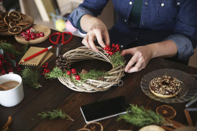 Woman decorating Advent wreath, partial view — Stock Photo