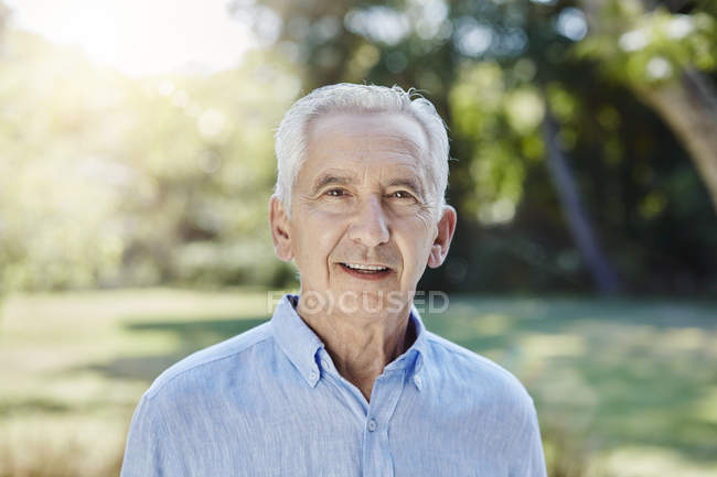 Portrait of senior adult man in park — Stock Photo