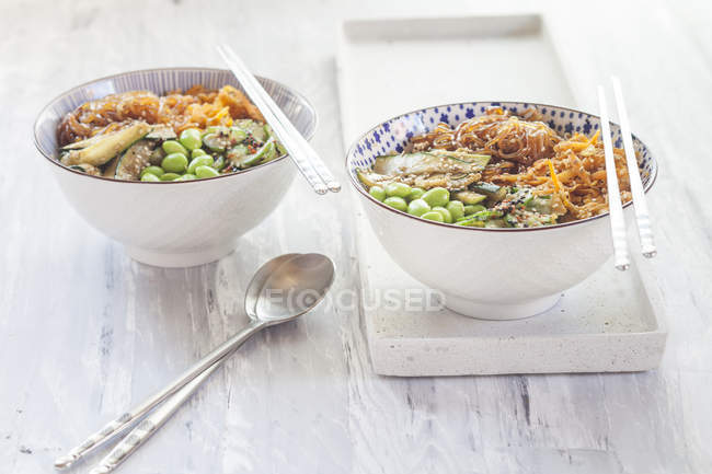 Buddha bowls of Edamame, cucumber, carrots, courgettes, Shirataki noodles and sesame — Stock Photo
