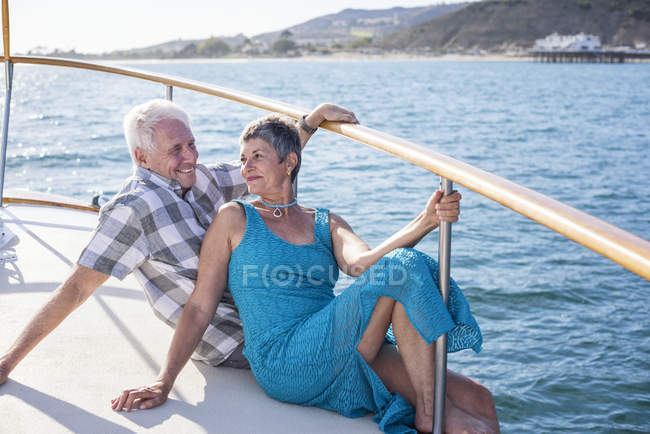 Happy couple on a boat trip sitting together — Stock Photo