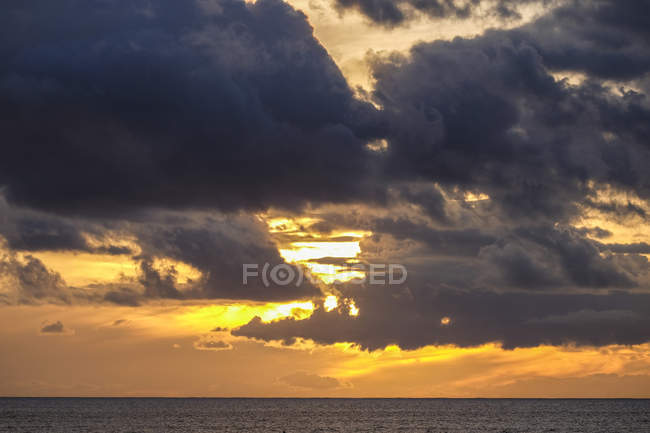 Spain, Temerife, cloudy sky at sunset over water — Stock Photo