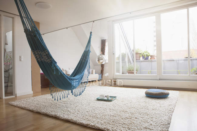 Modern Home interior with hammock and carpet — Stock Photo