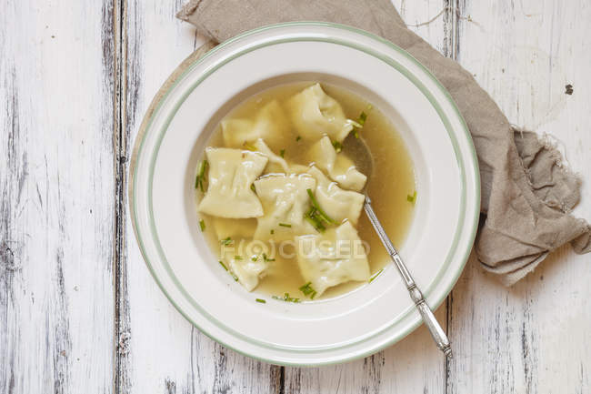 Top view of Swabian pockets soup in bowl — Stock Photo