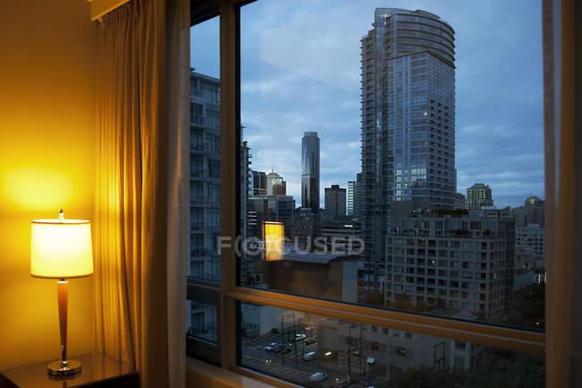 Canada, Vancouver, skyscrapers seen through window of hotel room — Stock Photo